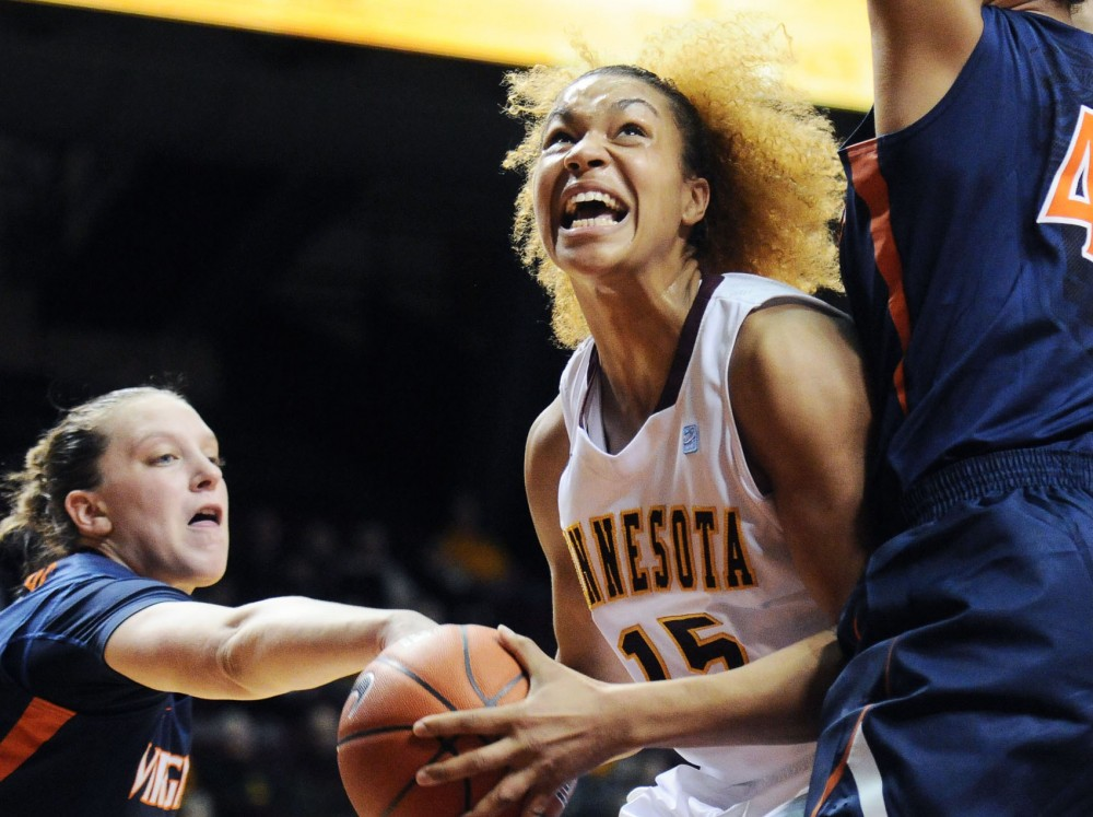 Minnesota forward Michëlla Riché (15) tries to get past Virginia player Simone Egwu to score at the game against Virginia at Williams Arena Thursday night.