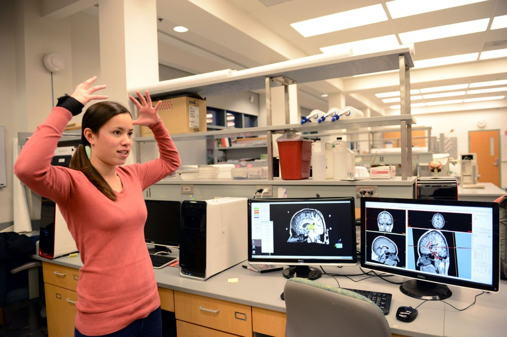 Graduate biomedical engineering student Allison Connolly talks to high school students about the deep brain stimulation project for treating Parkinsons disease Wednesday at professor Matthew Johnsons neuroengineering lab. Connollys presentation was part of the STEM Readiness program.