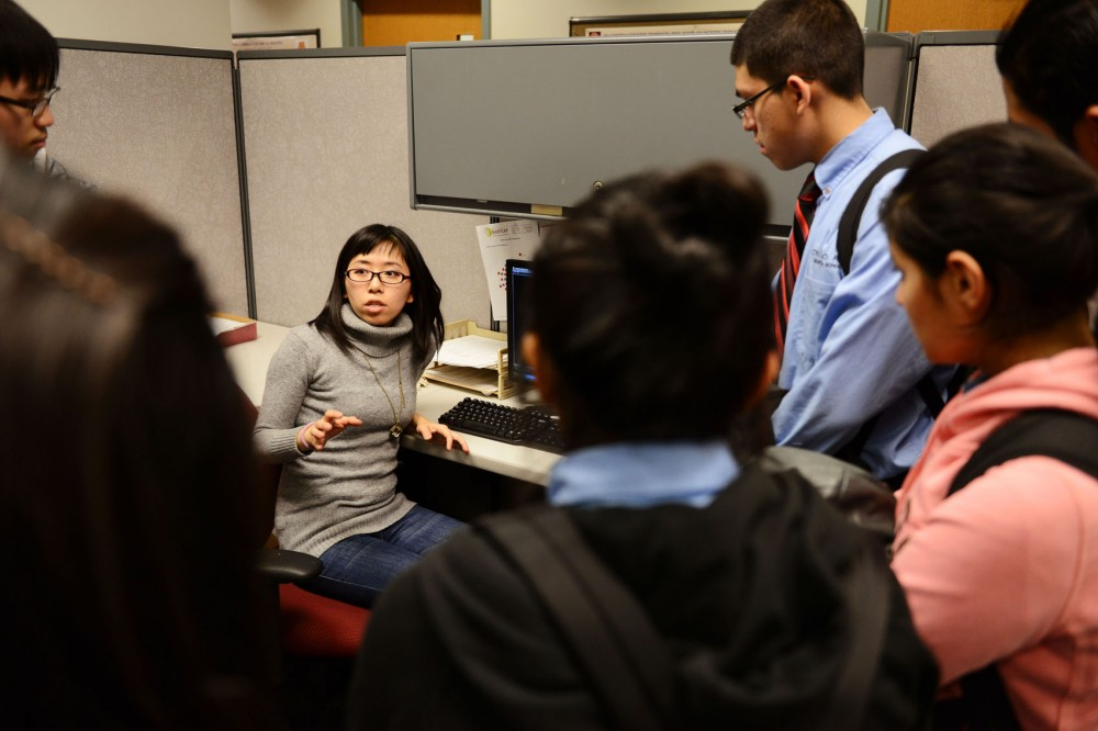Graduate biomedical engineering student Clara Zhang explains her project that uses electroencephalograms to measure the brain for epilepsy signs. Zhang presented for high school juniors part of the STEM Readiness program Wednesday at the Biomedical Functional Imaging and Neuroengineering Lab.