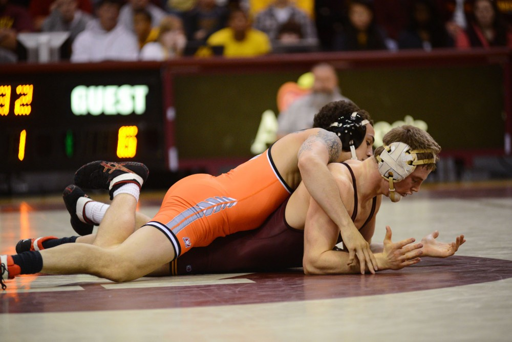 Minnesota's Seth Lange (149) wrestles against Oklahoma State's Jordan Oliver on Sunday at the Sports Pavilion. The Gophers lost 22-15 to Oklahoma State.
