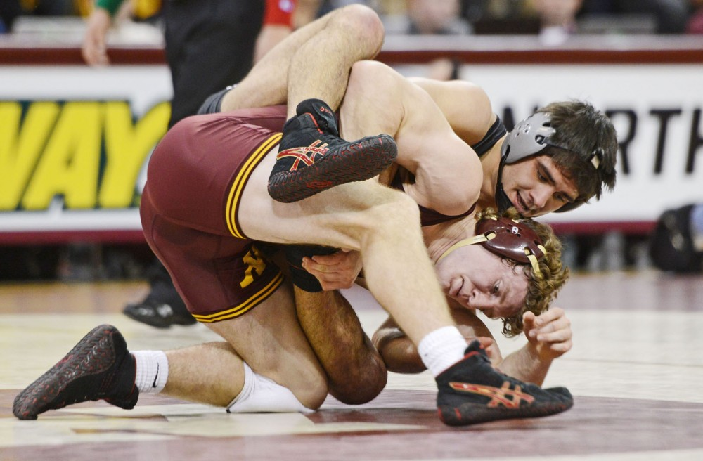 Minnesota's Kevin Steinhaus (184 pounds) wrestles Northwestern's Marcus Shrewsbury on Friday at the Sports Pavilion. The Gophers defeated the Wildcats 33-7.
