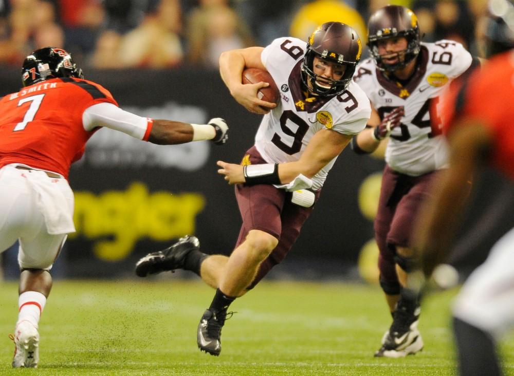 Minnesota quarterback Philip Nelson rushes through Texas Tech's defense.