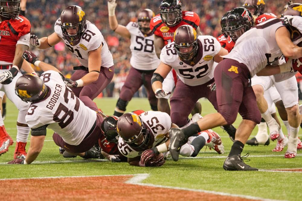 Minnesota running back Rodrick Williams Jr. scores a touchdown.