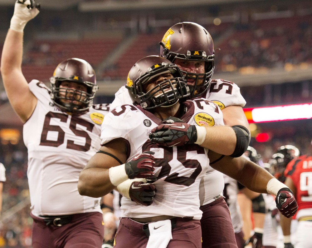 Minnesota running back Rodrick Williams Jr. celebrates after a touchdown.