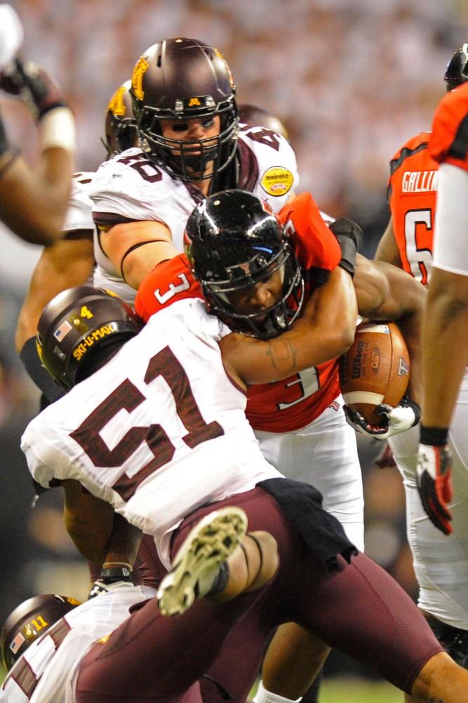 Minnesota linebacker Keanon Cooper tackles Texas Tech wide receiver Tyson Williams.