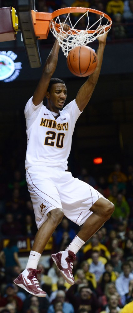 Minnesota guard Austin Hollins (20) scores a dunk against Nebraska on Jan. 29, 2013 at Williams Arena.