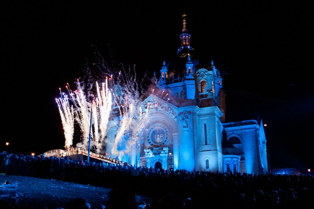 Fireworks explode over the Red Bull Crashed Ice course before the start of the event Saturday, Jan. 26, 2013, in St. Paul.