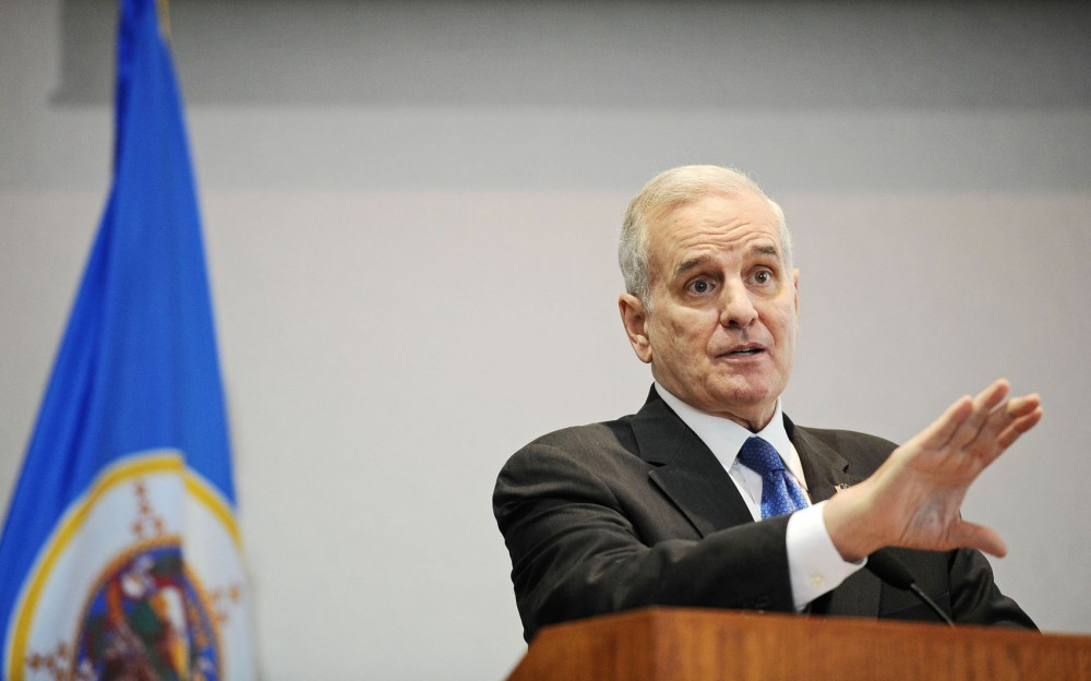 Gov. Mark Dayton presents his budget proposal at the Minnesota Department of Revenue on Tuesday, Jan. 22, 2013, in St. Paul, Minn.