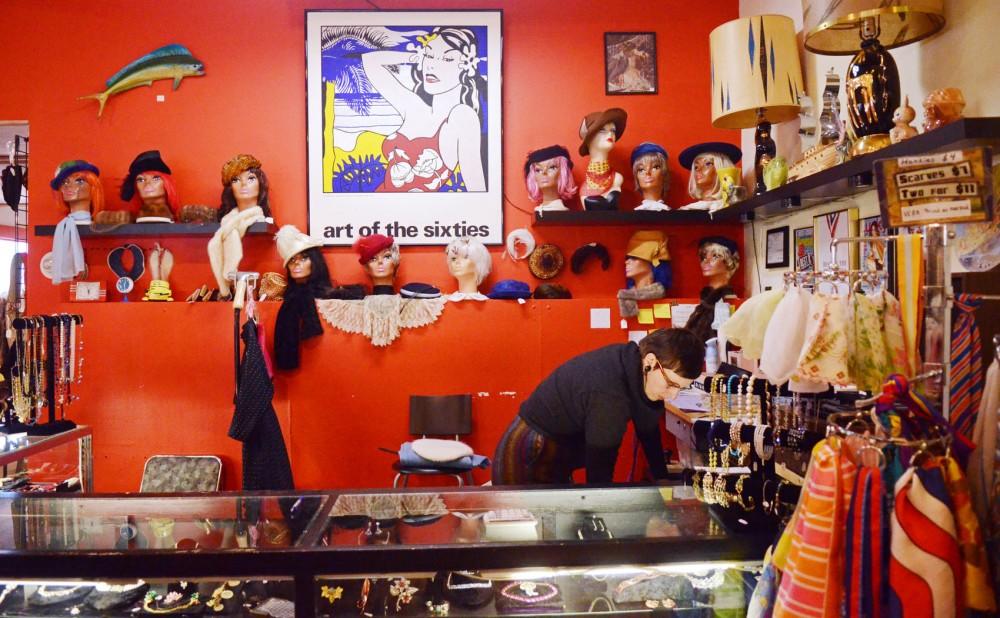 Blacklist Vintage owner Vanessa Messersmith works behind the counter at Blacklist Vintage on Jan. 17, 2013, in Minneapolis.