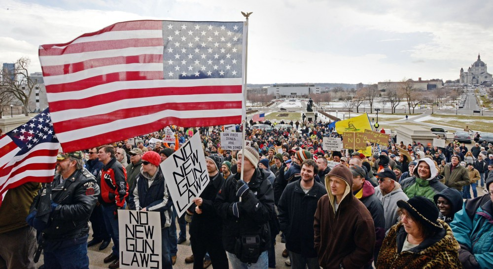 Anti-gun control protesters gather on the steps of the state Capitol for Gun Appreciation Day on Saturday, Jan. 19, 2013, in St. Paul, Minn.