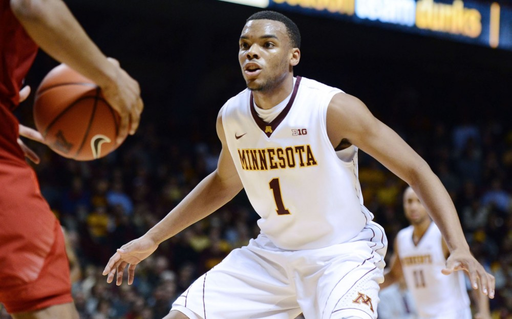 Minnesota guard Andre Hollins defends Nebraska guard Dylan Talley on Jan. 29, 2013, at Williams Arena.