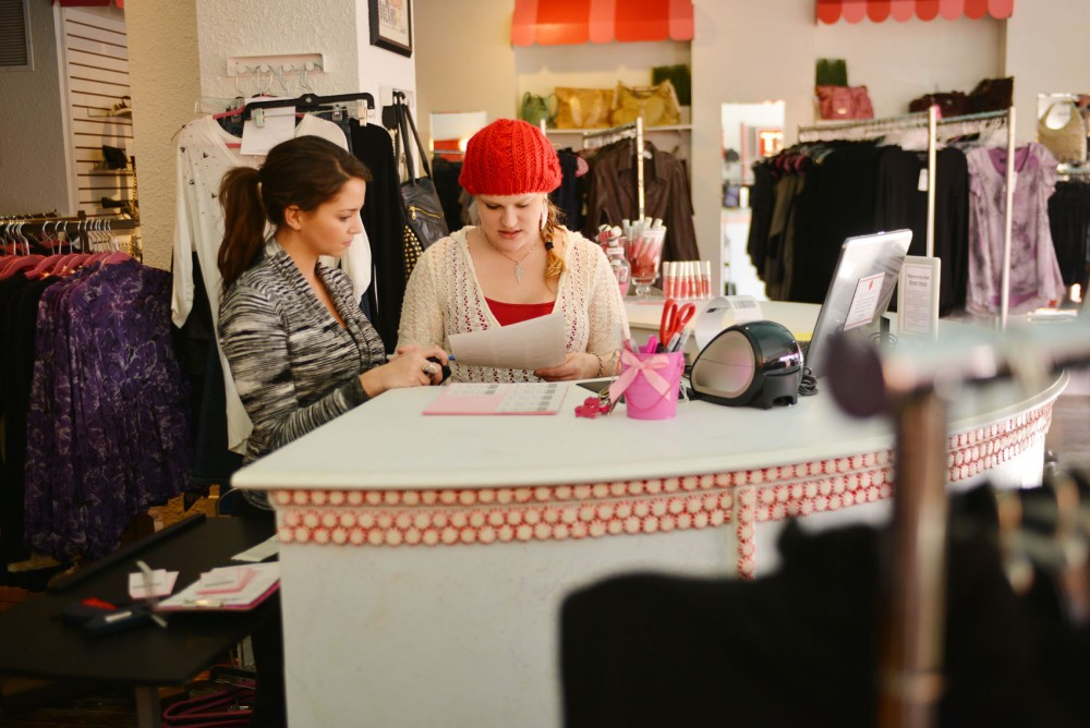 Peppermint Park employee Emily Kaehler and Vice President of Operations  Danielle Klein check barcodes on Wednesday, Jan. 23, 2013, in Dinkytown.
