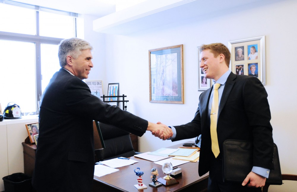 Chris Tastad, right, shakes hands with State Rep. Joe Atkins, DFL-Inver Grove Heights, after a meeting at the Minnesota State Office Building on Monday, Jan. 28, 2013, in St. Paul.