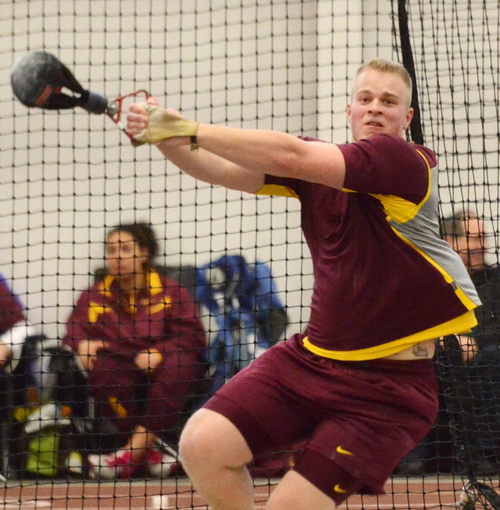 Minnesota thrower Jon Lehman throws at the Jack Johnson Invitational on Jan. 19, 2013, at the Field House. Lehman won the event with a distance of 20.26 meters.