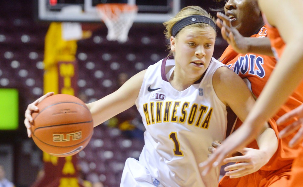 Minnesota guard Rachel Banham pushes though Illinois' defense Monday, Jan. 28, 2013, at Williams Arena. Banham scored her 1,000th point during the Gophers' 91-86 loss.