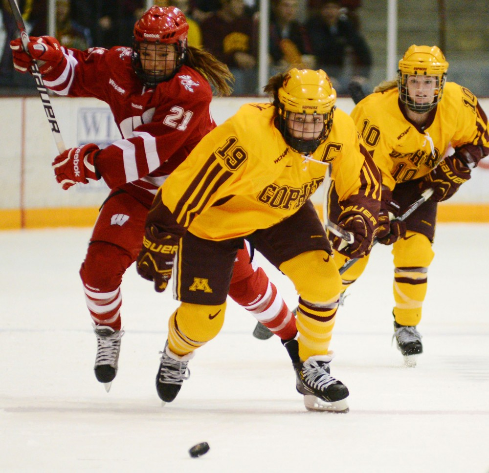 Minnesota defenseman Megan Bozek chases the puck down the ice during a game against Wisconsin on Sunday, Dec. 2, 2012, at Ridder Arena.