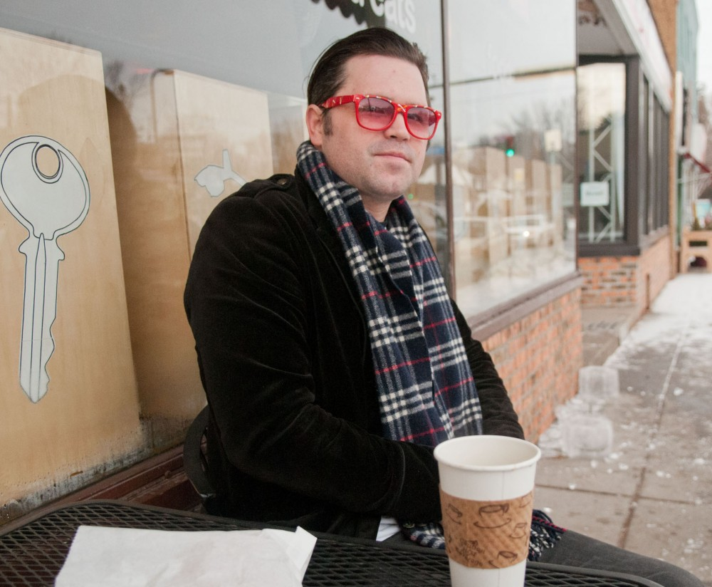 Actual Wolf's Eric Pollard finishes a cup of coffee outside his favorite Minneapolis haunt, The Coffee Shop Northeast, before driving back to his native Grand Rapids, Minn., on Friday, Jan. 18, 2013.