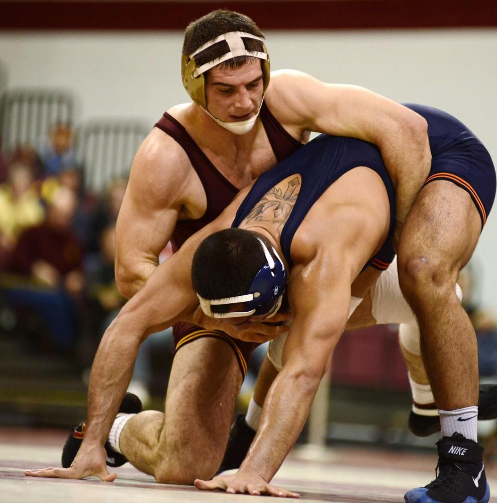 Minnesota's Scott Schiller (197) takes down Illinois' Mario Gonzalez on Monday, Jan. 21, 2013, at the Sports Pavilion.