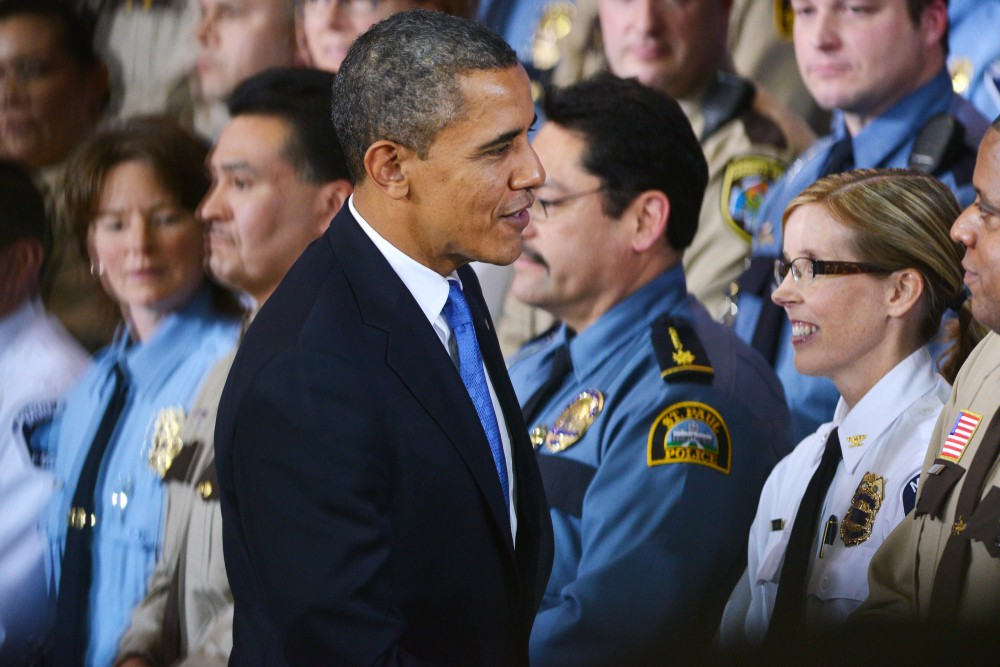 After his speech for more gun control, President Barack Obama greets members of law regulation on Feb. 4, 2013 at the Minneapolis Police Department Special Operations Center.