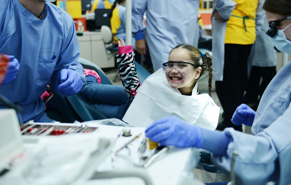 Patient Cherish Henderson smiles after getting her teeth cleaned Saturday, Feb. 2, 2013, at Moos Tower.