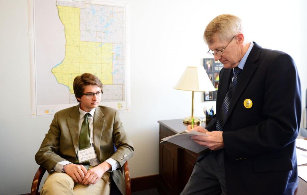 Minnesota-Morris junior Matt Fredericks meets with Rep. Jay McNamer at the State Office Building on Monday, Feb. 25, 2013, in St. Paul. Students across Minnesota joined Fredericks on the Energy Lobby Day and met with legislatures about renewable energy policies.