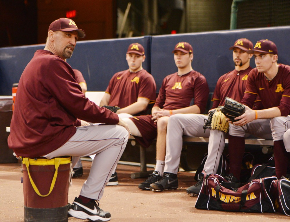 Gophers pitching coach Todd Oakes speaks to his players at practice Monday, Feb. 11, 2013, at the Metrodome.