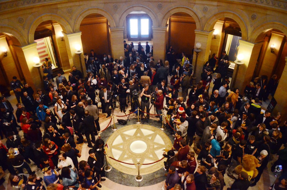 University supporters congregate in the Capitol rotunda on Thursday, Feb. 7, 2013, in St. Paul.