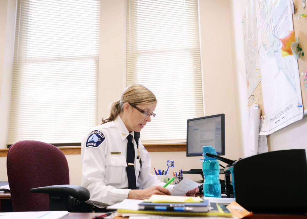 Police Inspector Kathy Waite looks over updated crime statistics on Wednesday in her office at the Second Precinct station in Minneapolis. The new inspector was the first appointment made by Minneapolis Police Chief Janeé Harteau, who took office in December.