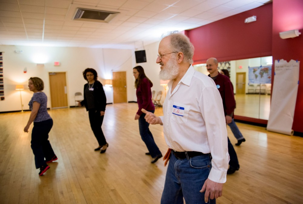 Instructor Ed Stern teaches dance steps to the Beginning International Folk Dance class on Friday, Feb. 22, 2013, at the Tapestry Folkdance Center in Minneapolis. Stern teaches ethnic dances from all around the world.