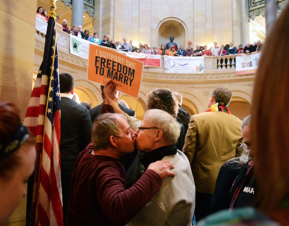 Clark McDonald and Walt Oberstar kiss while gay marriage supporters rally Thursday, Feb. 14, 2013, at the Capitol. McDonald and Oberstar have been together for 30 years and were married in 2008 in Toronto.