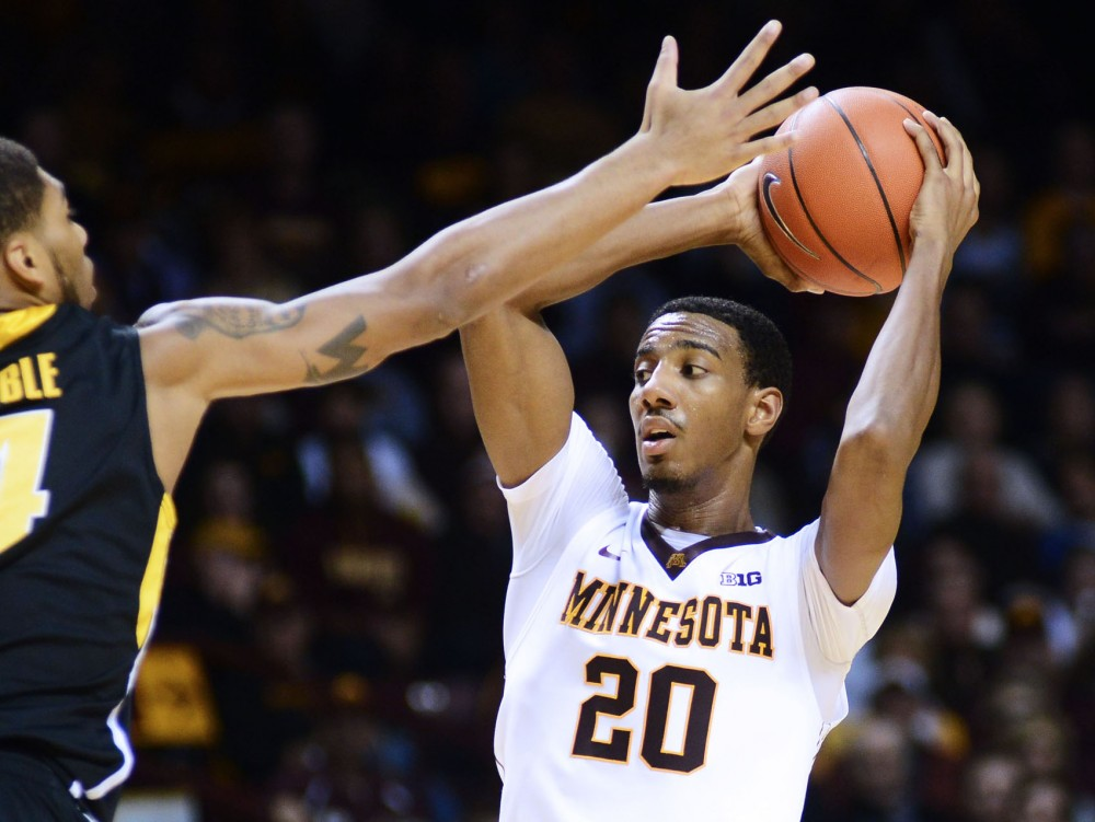 Minnesota guard Austin Hollins looks for an open pass against Iowa on Sunday, Feb. 3, 2013, at Williams Arena.