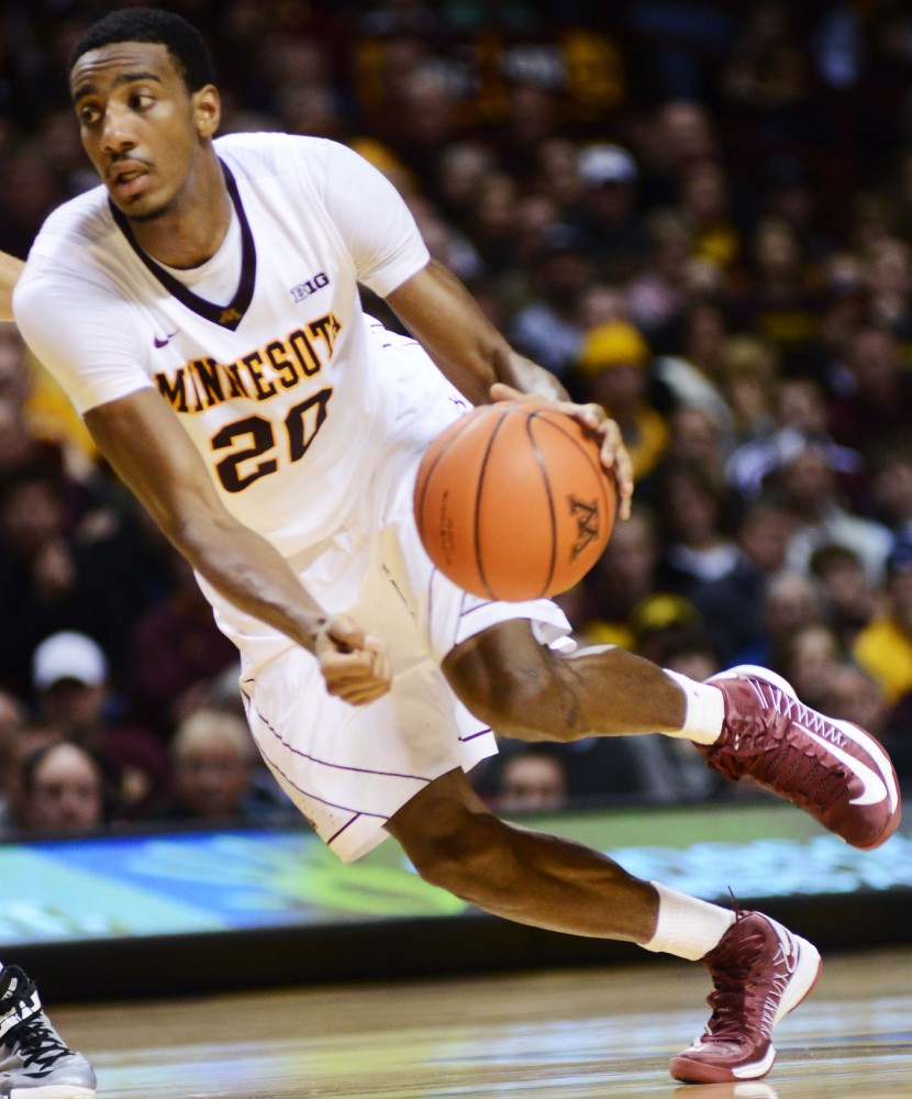 Minnesota guard Austin Hollins drives to the basket against Iowa on Sunday, Feb. 3, 2013, at Williams arena.