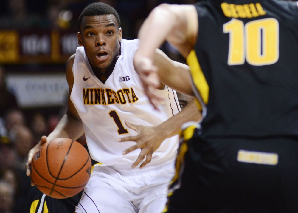Minnesota guard Andre Hollins dribbles the ball down the court against Iowa on Sunday, Feb. 3, 2013, at Williams Arena.
