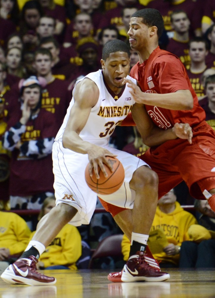 Minnesota forward Rodney Williams Jr. tries to pass Nebraska guard Shavon Shields on Tuesday, Jan. 29, 2013, at Williams Arena.