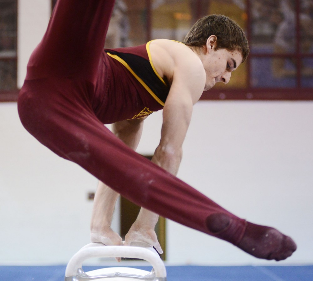 Sophomore Ellis Mannon competes on the pommel horse Saturday, Feb. 2, 2013, at the Sports Pavilion.