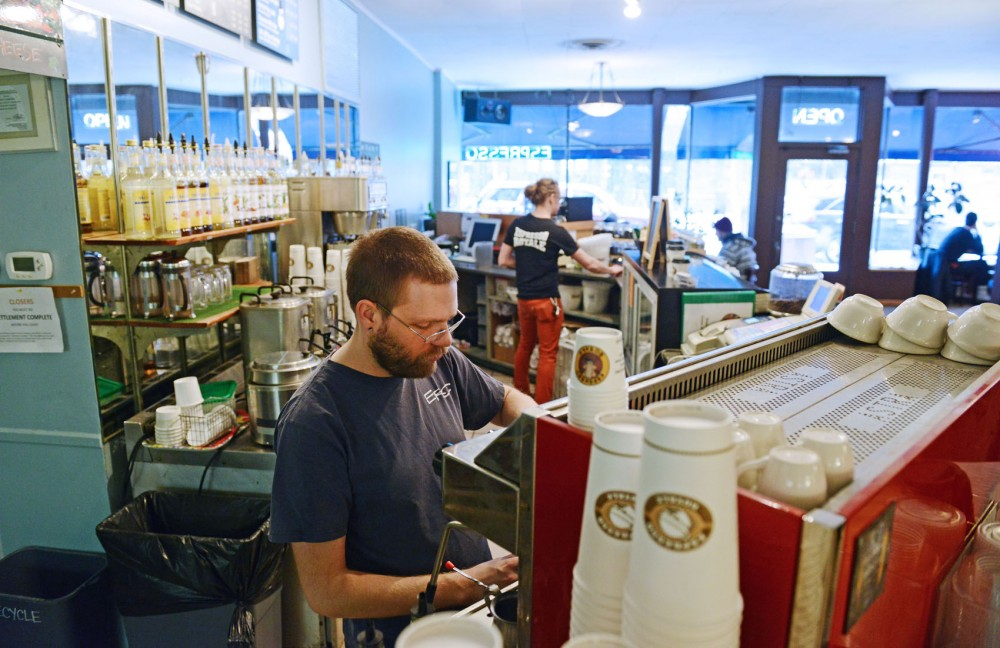 Assistant manager Rex Vogen, left, and employee Chris Buchel of Espresso Royal prepare drinks Friday, Feb. 1, 2013, in Dinkytown. Vogen says he thinks that a raise in minimum wage would be a good thing because minimum wage needs to be livable.