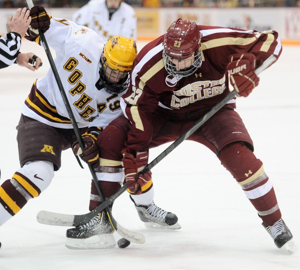 Minnesota forward Erik Haula battles for the puck against a Boston College player Dec. 30, 2012, at Mariucci Arena.