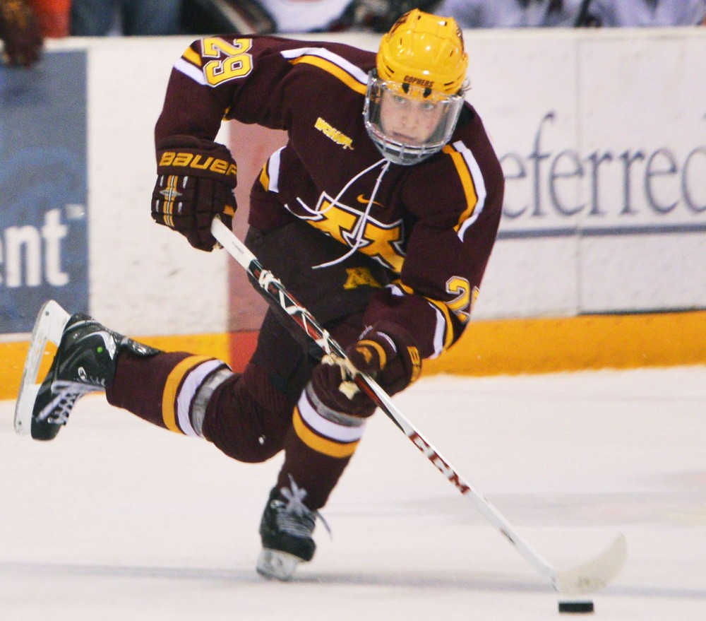 Minnesota defender Nate Schmidt drives down the ice Saturday, Feb. 9, 2013, at the St. Cloud National Hockey and Event Center. Schmidt has scored a goal during each of the past four games.