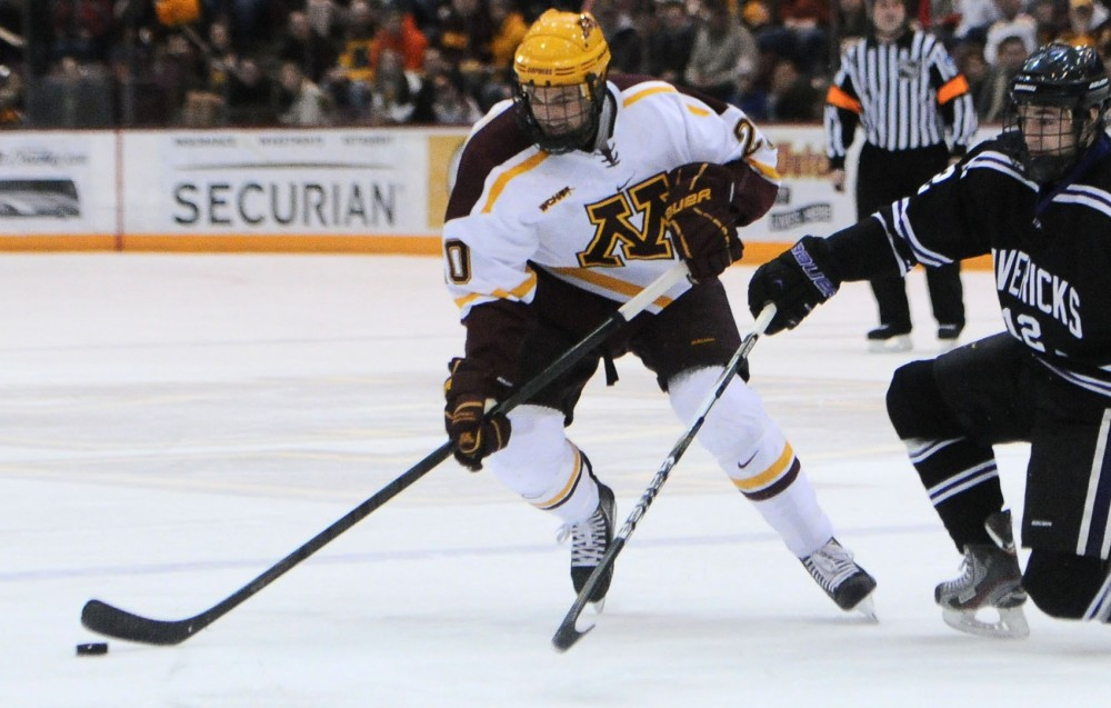 Minnesota defenseman Mark Alt battles for the puck against Minnesota State-Mankato on Friday, Jan. 25, 2013, at Mariucci Arena.