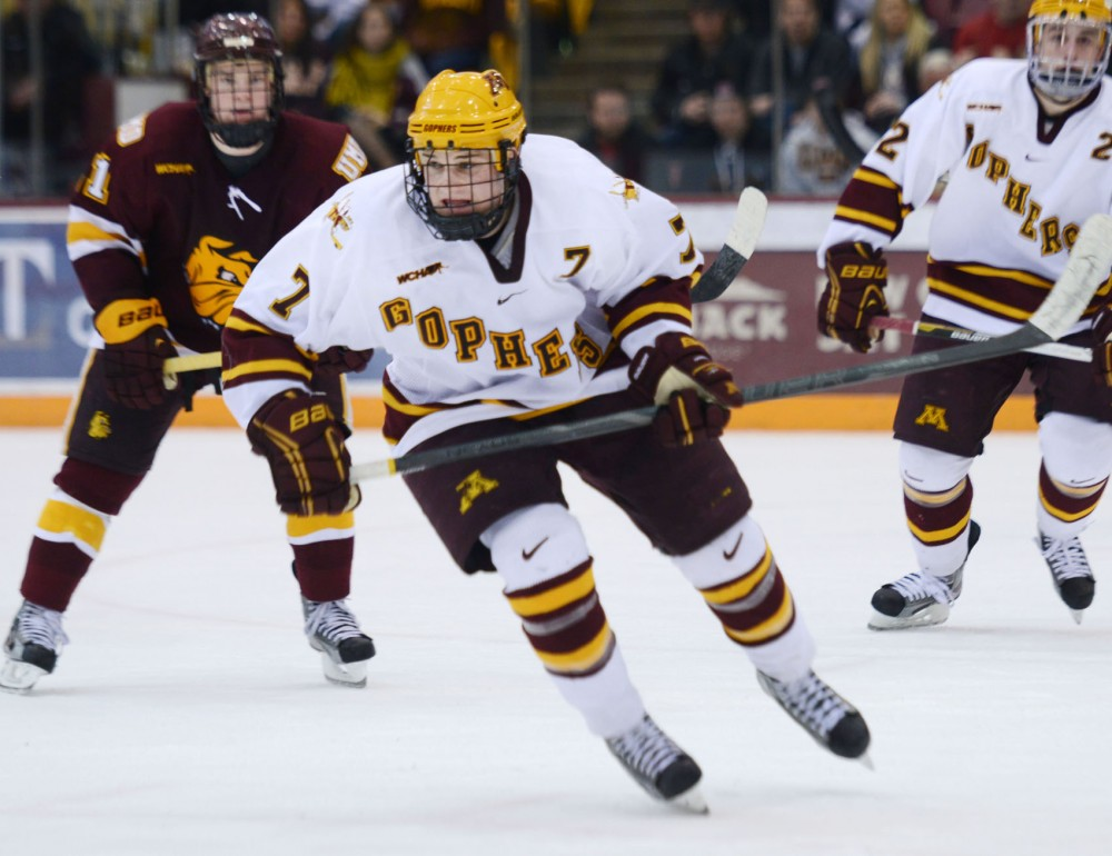 Minnesota forward Kyle Rau chases the puck against Minnesota-Duluth on Saturday, Feb. 23, 2013, at Mariucci Arena.