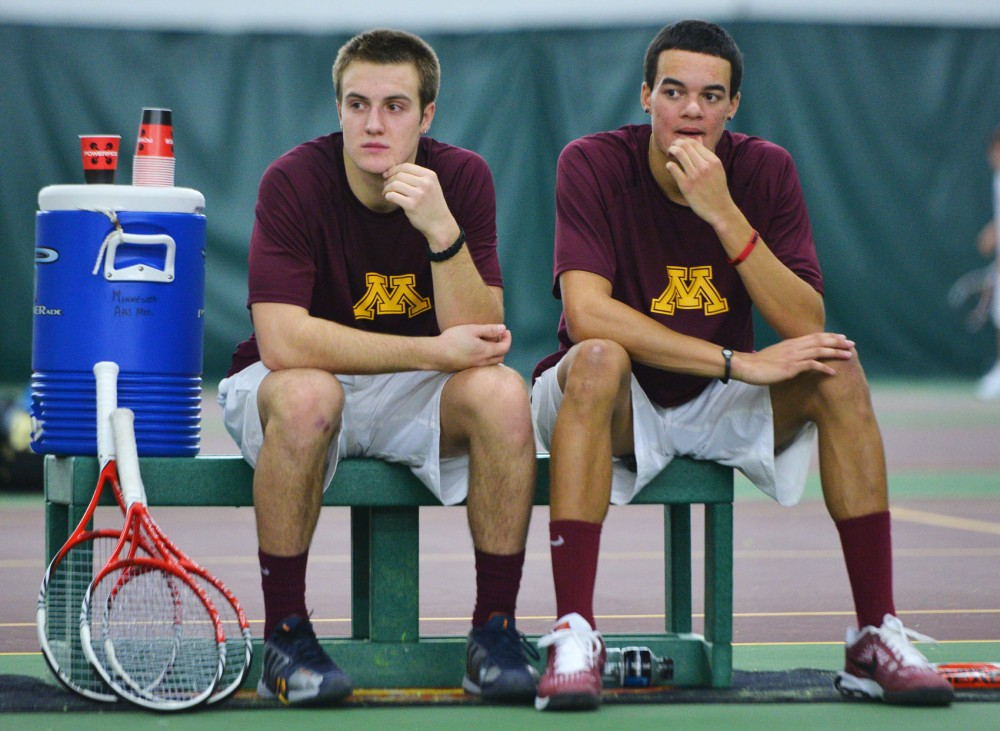 Minnesota's Jack Hamburg and Brendan Ruddock rest after their doubles match against Boise State on Saturday, Feb. 9, 2013, at the Baseline Tennis Center.