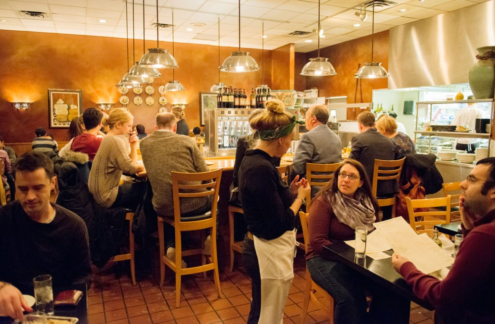 Diners enjoy their meals on Monday, Feb. 11, 2013, at Broder's Pasta Bar in south Minneapolis. The bar seating provides the best view of the pasta chefs at work.