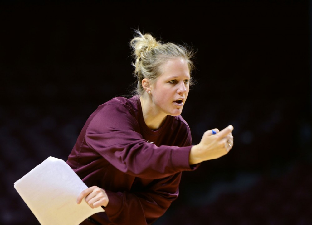 Former Gophers basketball player and current assistant coach Kelly Roysland works with her players Wednesday, Feb. 20, 2013, at Williams Arena.