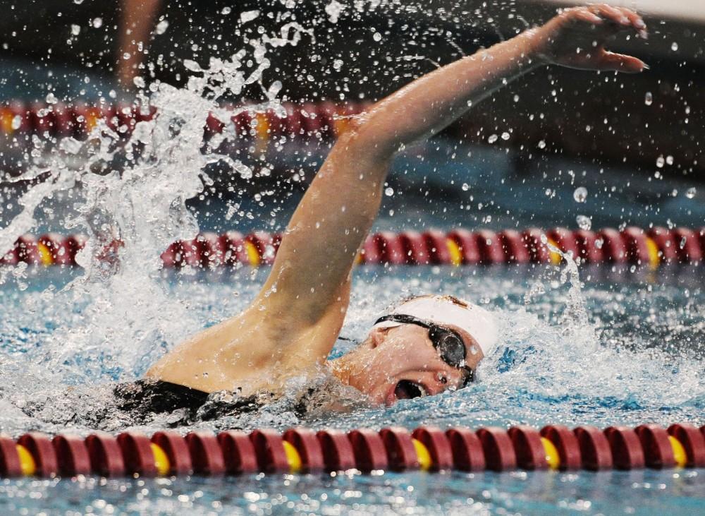 Minnesota's Kiera Janzen swims the 1,000-yard freestyle against Wisconsin on Friday, Oct. 26, 2012, at the University Aquatic Center.