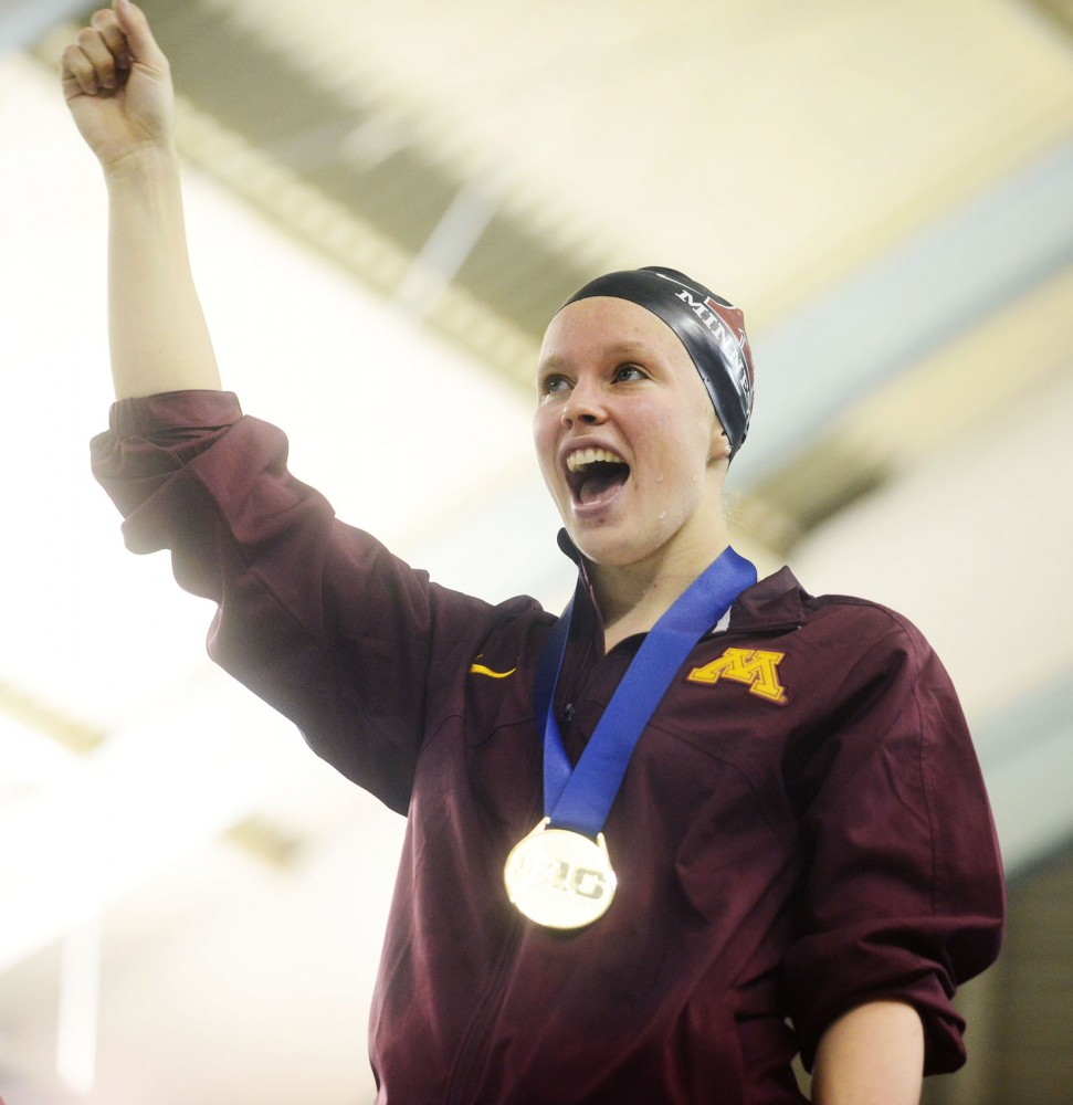 Minnesota swimmer Haley Spencer celebrates after winning the 100-yard breaststroke at the Big Ten championships Friday, Feb. 22, 2013, at the University Aquatic Center.