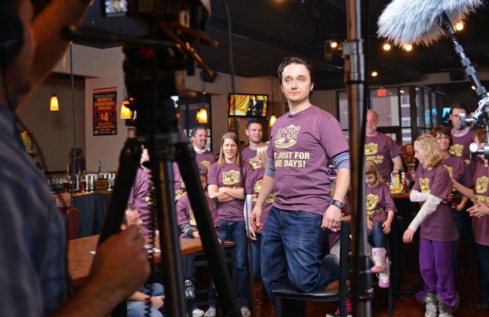 KSTP commercial producer Nick Tieri sets up the camera to shoot a scene of the Stadium Village commercial Friday, Feb. 1, 2013, at the Hole Sports Lounge.