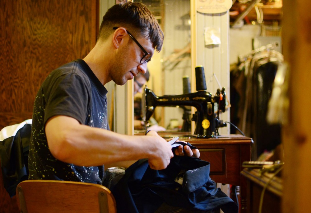 Designer Max Lohrbach cuts material for one of his pieces Monday, Feb. 18, 2013, in Minneapolis. Lohrbach will be showing his work in the first night of The Shows at Aria.