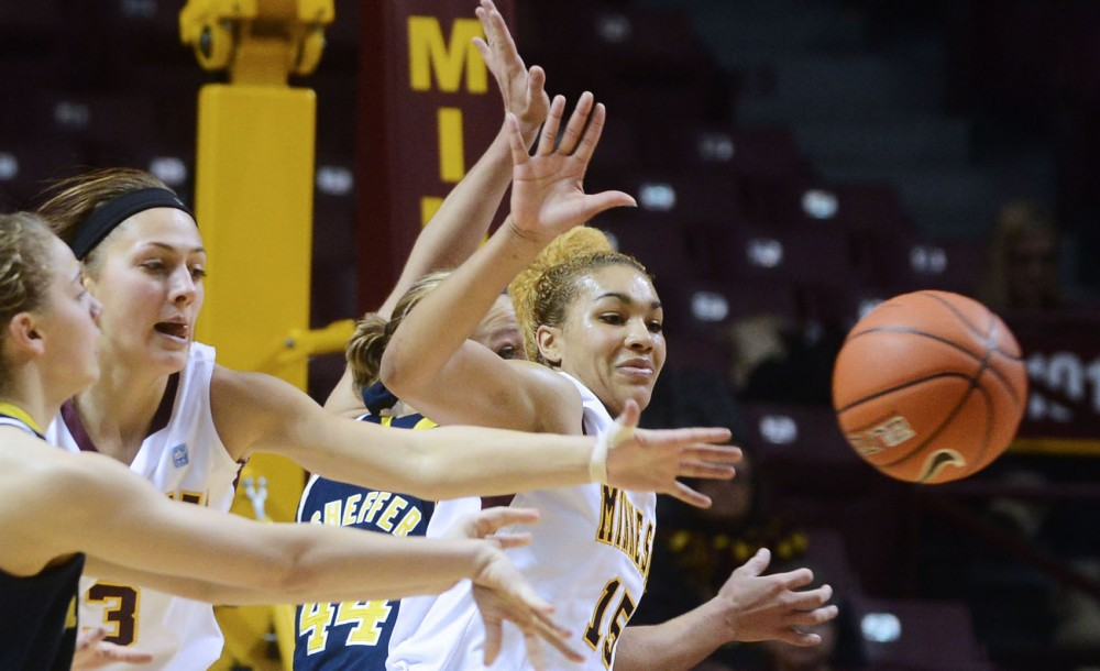 Minnesota forward Micaëlla Riché rushes for the ball while Minnesota guard Shayne Mullaney covers Thursday, Jan. 31, 2013, at Williams Arena. The Gophers defeated the Wolverines 82-67.