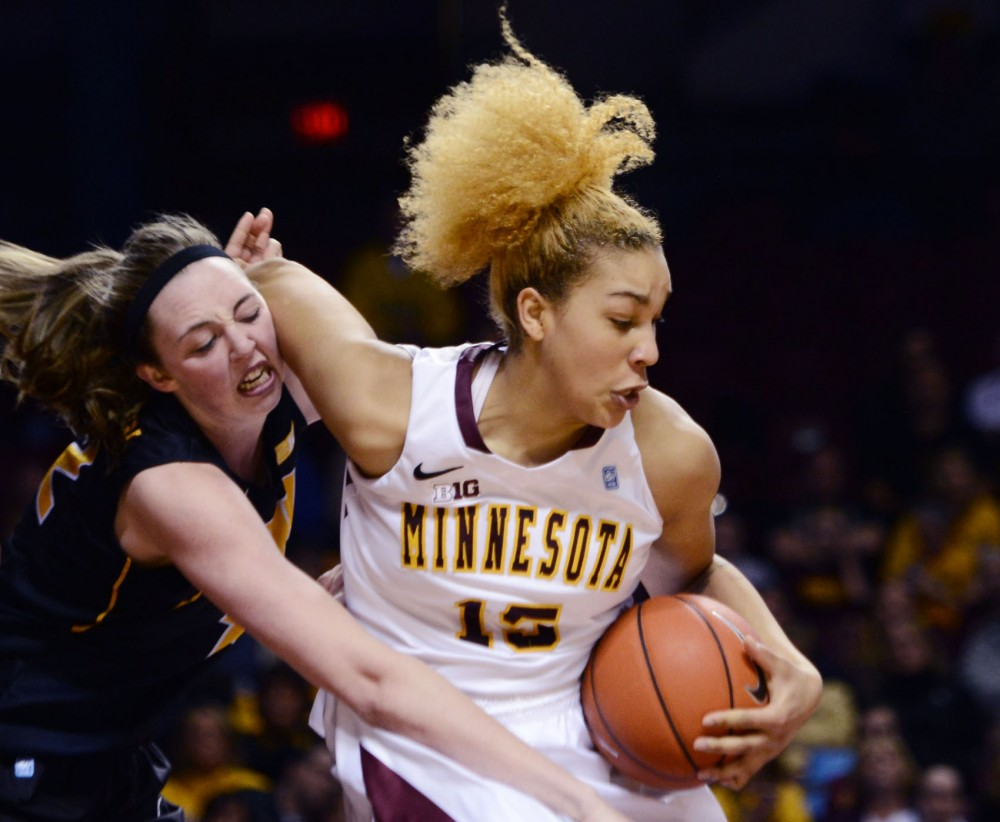 Minnesota forward Michëlla Riché takes the ball to the hoop against the Hawkeyes on Thursday, Feb. 7, 2013, at Williams arena.