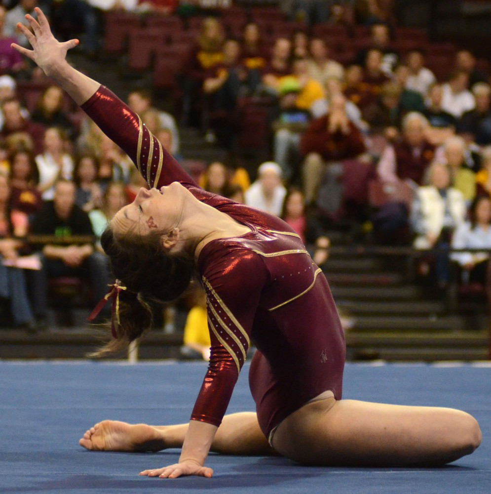 Minnesota's Cierra Tomson performs on the floor exercise Saturday, Feb. 9, 2013, at the Sports Pavilion. Tomson scored a 9.85 in the event.